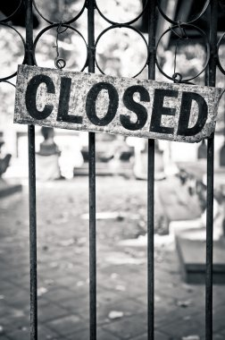 Closed sign on metal doors