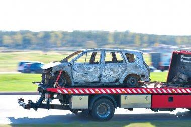 Burnt car on truck