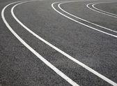 Fotografie Fahrspuren auf asphalt