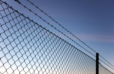 Chain link fence and barbed wire