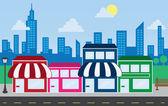 Shop-Fronten und Skyline-Gebäude