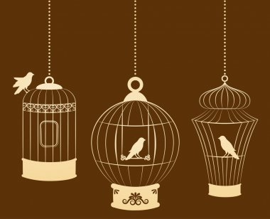 Vintage ornamental birdcages and birds