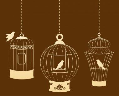 Vintage ornamental birdcages and birds
