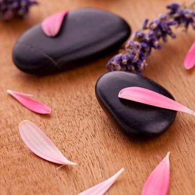 Black stones with leaves and lavender