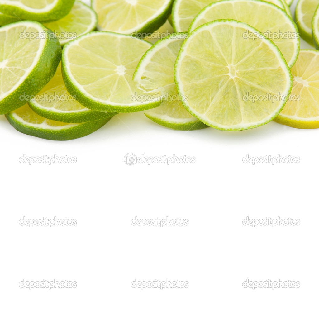 Green limes discs Fruit Cocktail on white backgorund