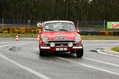 LEIRIA, PORTUGAL - APRIL 20: CArlos Marouco drives a Ford Cortina GT during Day One of Rally Verde Pino 2012, in Leiria, Portugal on April 20, 2012.