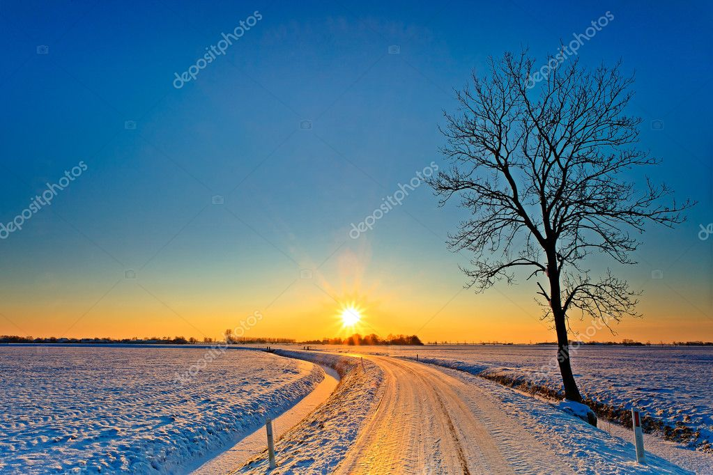 Sunset in a white winter landscape
