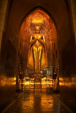 Statue of golden buddha in Ananda Pahto temple in Bagan - Myanmar (Burma)