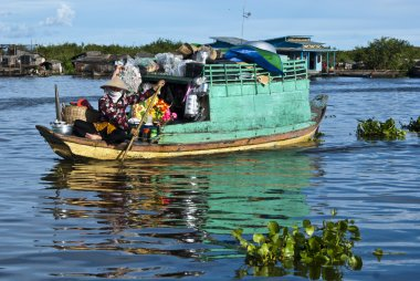 Vietnamese seller on a boat in the floating village on Tonle Sap - Cambodia
