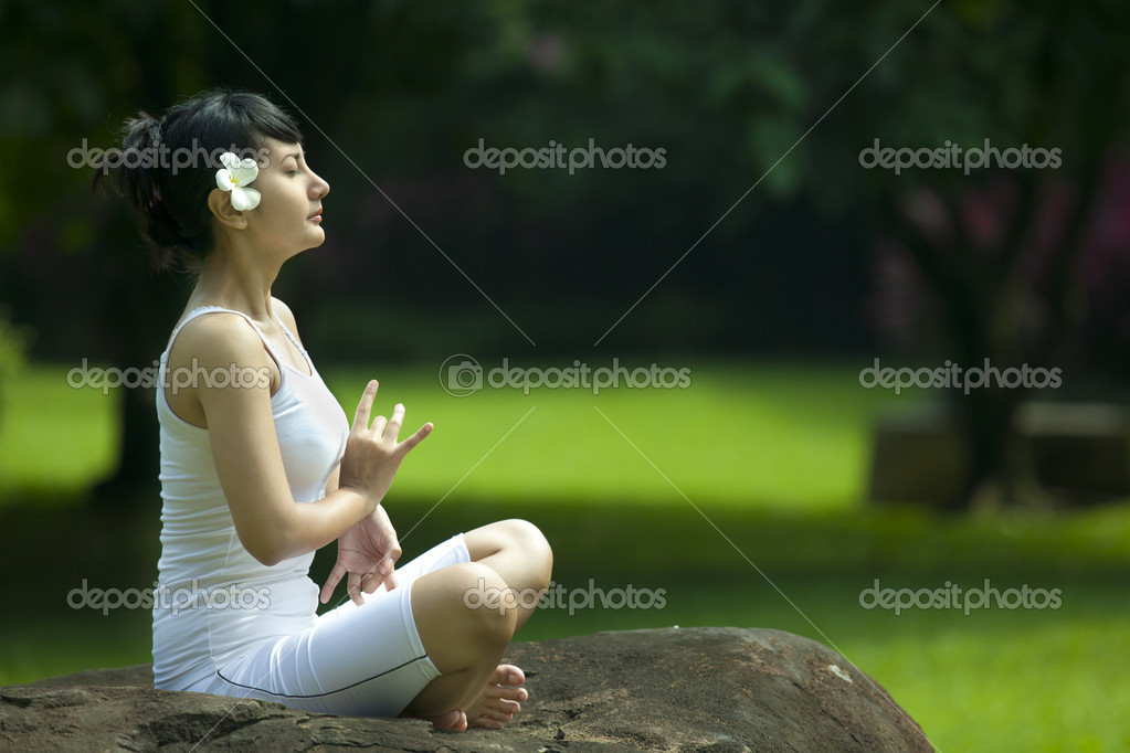 Beautiful Asian Woman Meditating outdoor