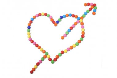 Heart made of colorful candy with arrow