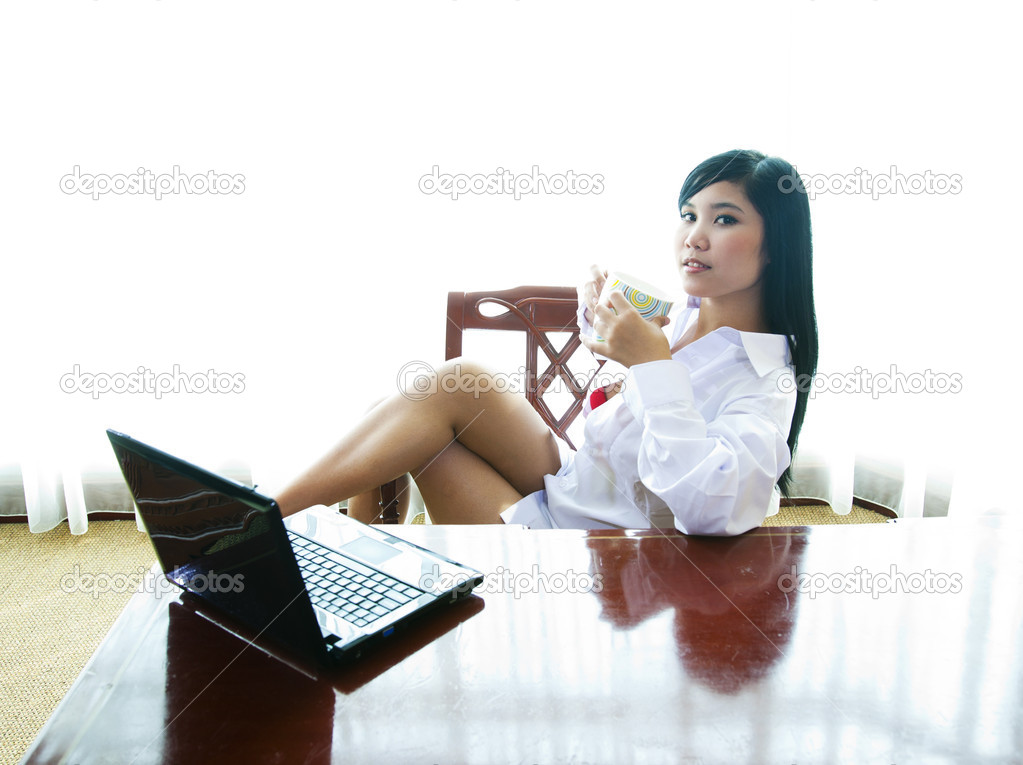 sexy businesswoman with laptop stock photo. Black Bedroom Furniture Sets. Home Design Ideas