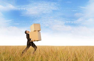 Businessman delivering boxes