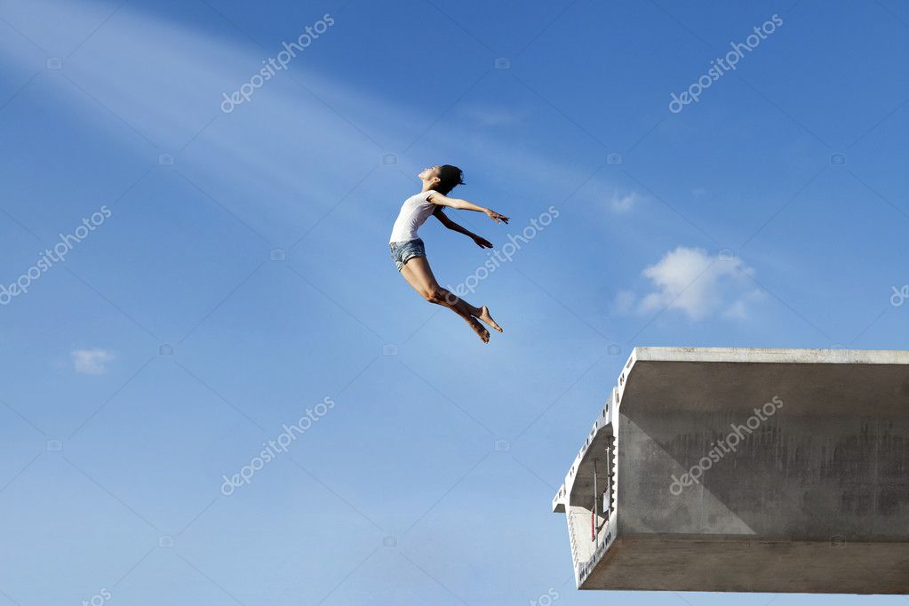 Girl jumping off a bridge