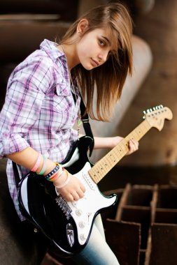 Style brunette girl with guitar
