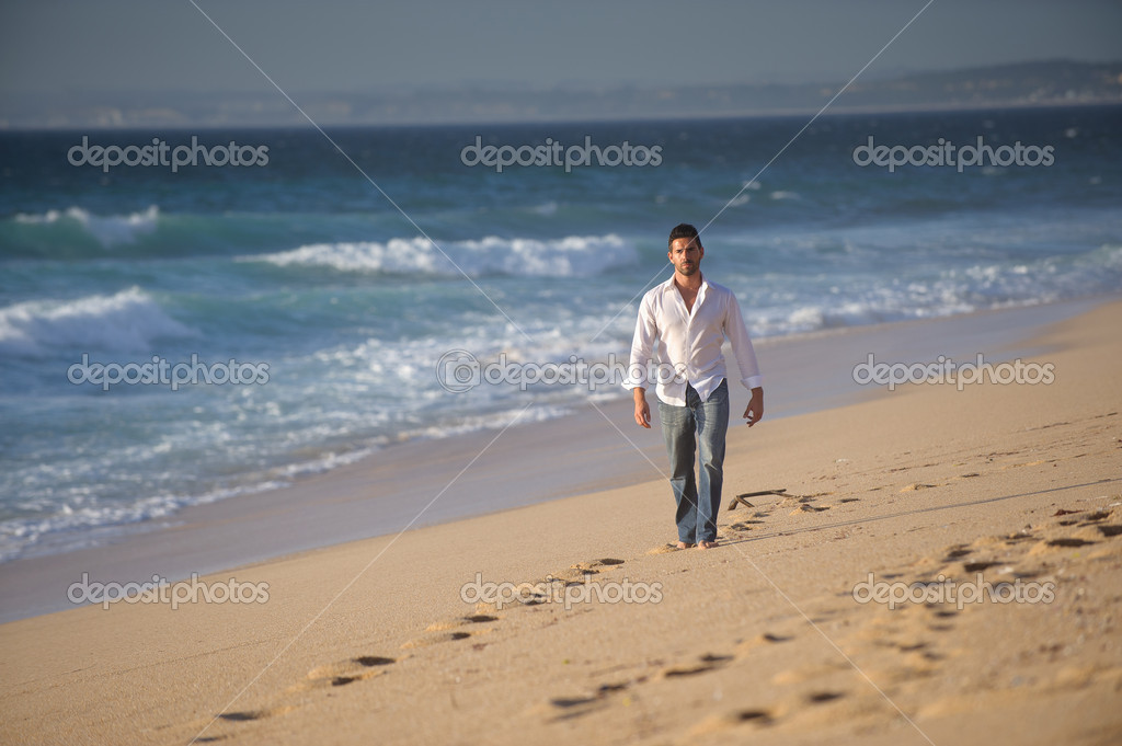 Man walking alone at the beach