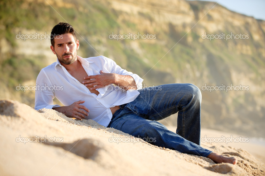 Man layed on the sand
