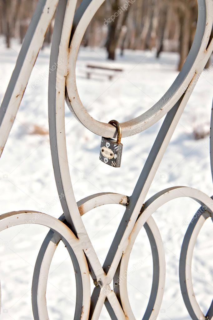 Old padlock on a bridge