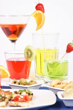 Appetizer and colored aperitif drinks