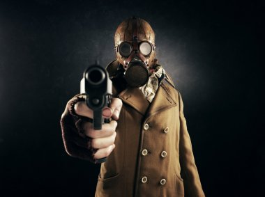 Grunge portrait man in gas mask pointing a gun