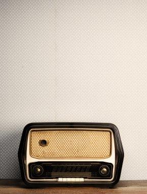 Antique radio on vintage background