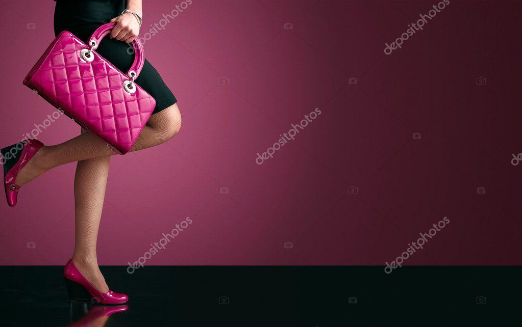 Woman sexy legs with handbag