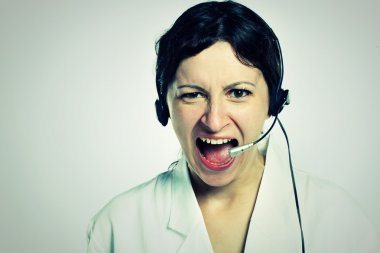 Portrait of angry girl with headset