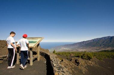 Two boys looking at a map at La Palma, Canary Islands