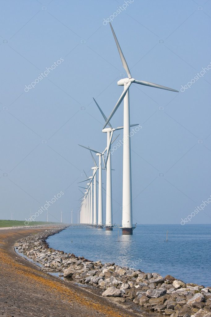 Long row of windmills, standing in the Dutch sea