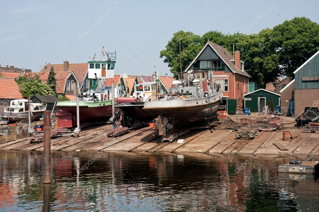 Old Dutch shipyard with tugboats — Stock Photo © kruwt #8013975