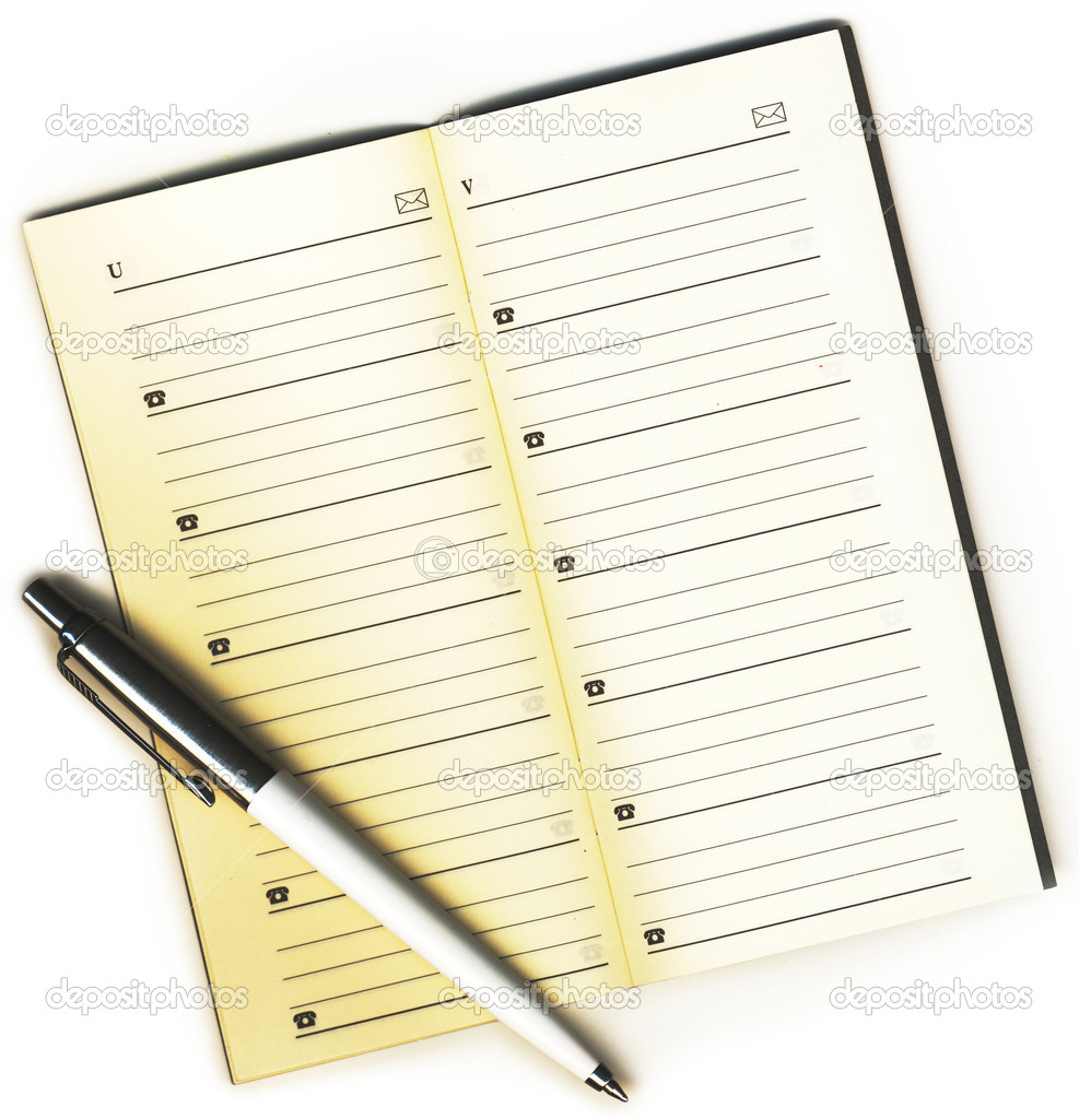 Address book and a pen on a white background isolated