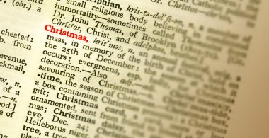 The meaning of the word CHRISTMAS highlighted in the dictionary. Shallow fo