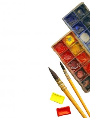 Creative Art Background made of old paint brushes, albums, palette, colore