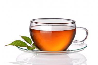 Tea cup with herbal leaves