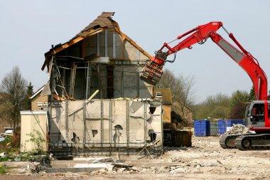Excavator demolishing a building
