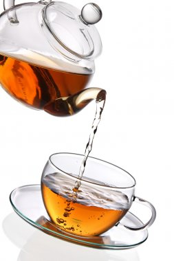 Tea poured into glass cup