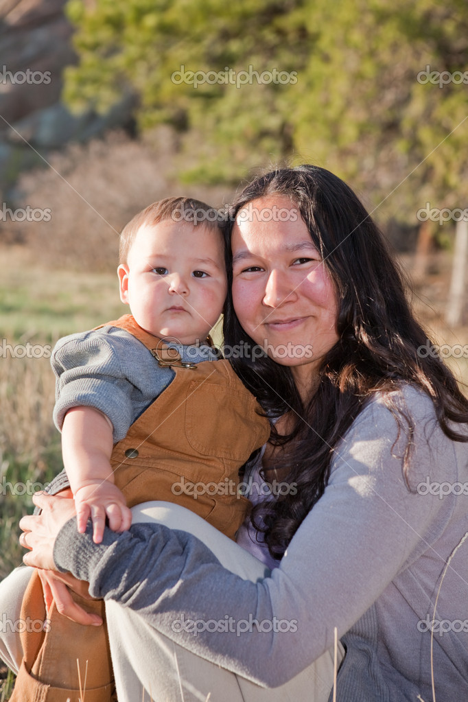 Mother and baby son outdoors