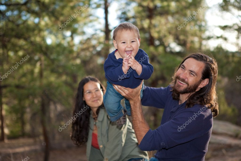 Young family having fun in nature