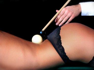 White billiard ball lying on his back naked female body