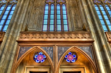 Arched ceiling with stained glass windows close up