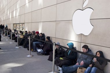 People Waiting in Line for the iPad 2 Release in Downtown Chicago, Illinois USA Outside of the Michigan Avenue Store