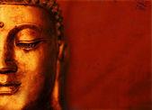 Fotografie Buddha tvář s červeným pozadím