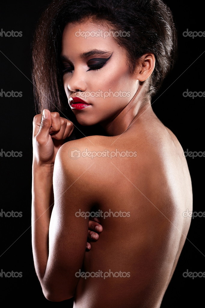 a8ebfce82 Fashion portrait of beautiful american black female brunette girl model  with bright makeup red lips nude
