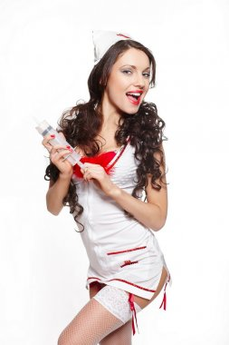 Sexy beautiful smiling female brunette doctor with big syringe red lingerie