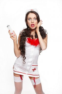Sexy beautiful surprised female brunette doctor with big syringe red linger