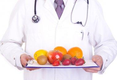 Doctor holding fresh fruit