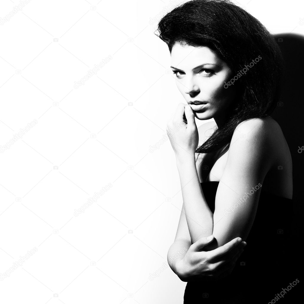 Fashion portrait of beauty woman, black and white, high contrast, studio sh