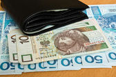 Fotografie Polish money - zloty, banknotes and wallet on the table