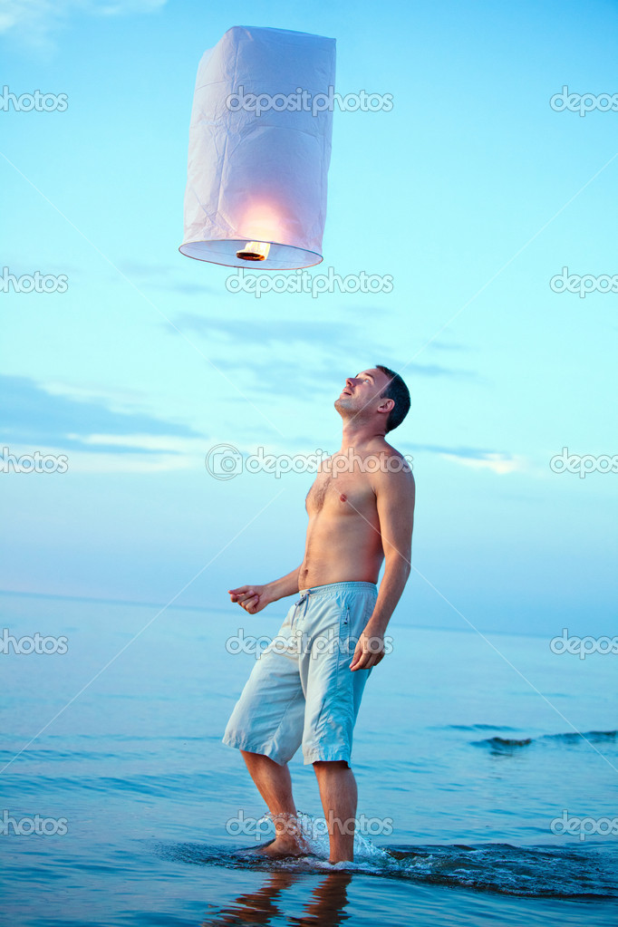 A young man with a fire lantern