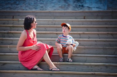 Mother and her little son outdoors in city